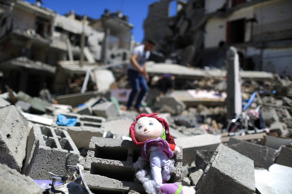 A Palestinian doll lies on the rubble of a destroyed building Abu Lealla family following an Israeli air strike in Gaza City on July 11, 2014. (Wissam Nassar/The New York Times)