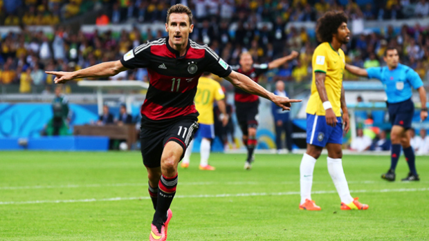 Miroslav Klose of Germany celebrates after scoring his team's second goal during the World Cup semifinal against Brazil