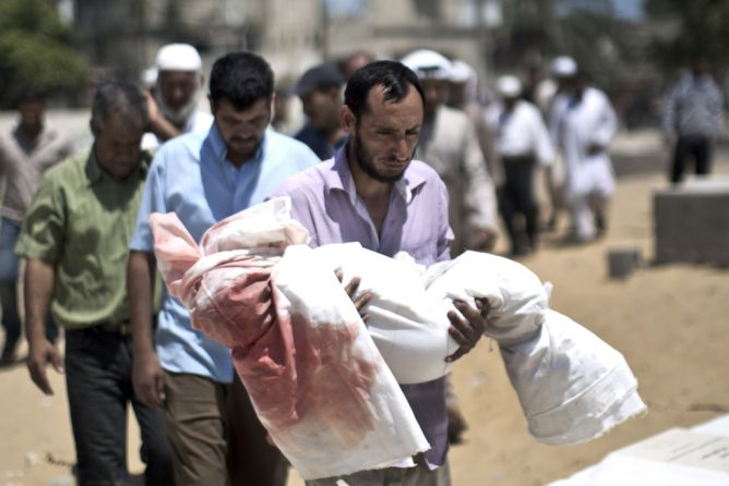 Palestinian mourners carry the body of five-year-old boy Abdallah Abu Ghazal during his funeral in the northern Gaza town of Beit Lahiya on July 10, 2014 after he was killed in an Israeli air strike. (MAHMUD HAMS/AFP/Getty Images)