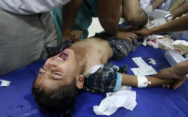 Medics tend to a boy injured in the shelling of a Gaza hospital. Photo: Reuters