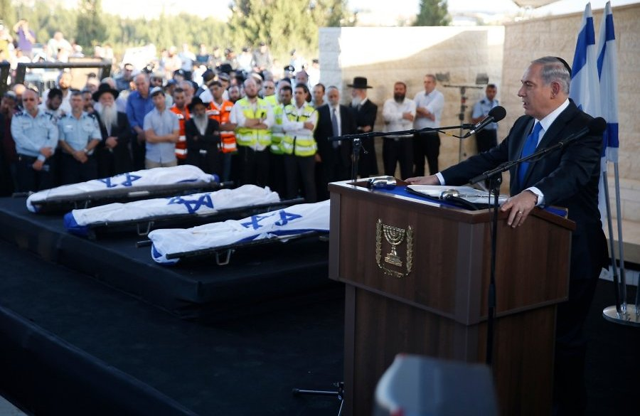 Israel's Prime Minister speaks at the funeral of three slain Israeli teenagers