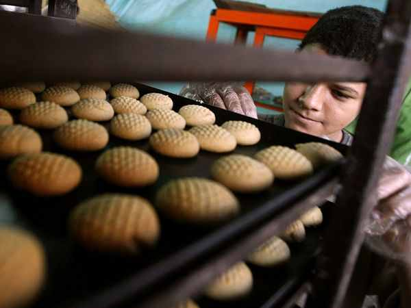 Kahk after baking on a cooling rack, before getting sprinkled with sugar and honey. Photograph by Kahled Desouki, AFP/Getty Images