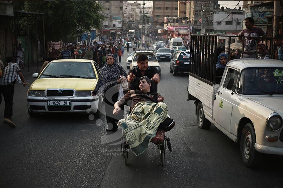 Palestinians fleeing what authorities have called a 'massacre' in Al-Shijaeya.
