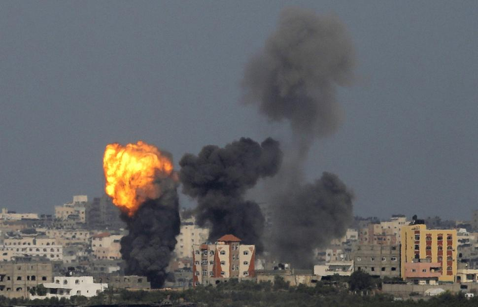 An explosion is seen on Sunday in the northern Gaza Strip after an Israeli air strike Photo: AMMAR AWAD/REUTERS