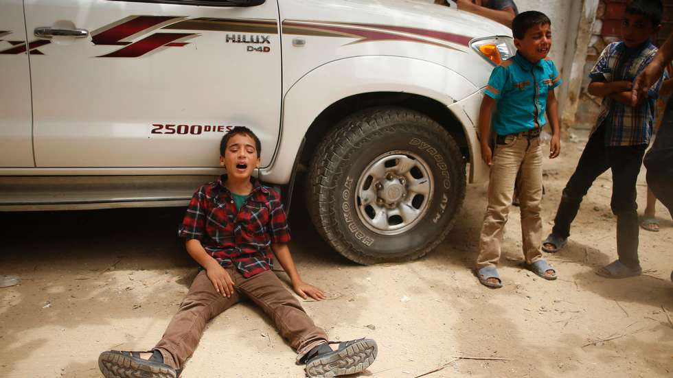 A boy mourns after the funeral for relatives of the Gaza police chief Tayseer al-Batsh, who officials said were killed in an Israeli air strike. Photo: Mohammed Salem/Reuters