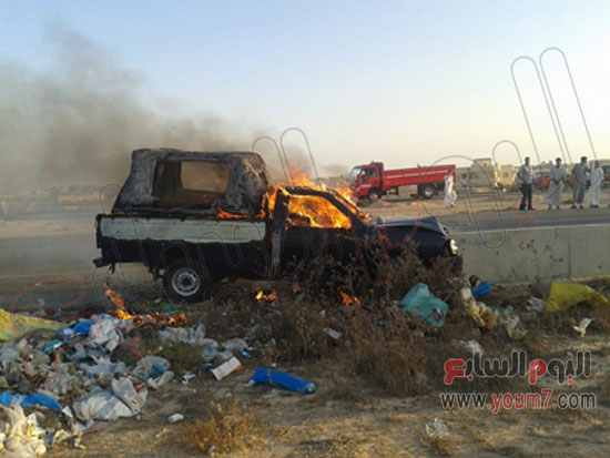 Police car catches fire after militant attack. Photo: Al-Youm7