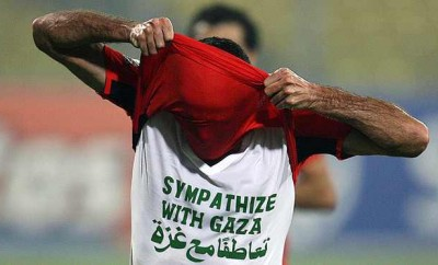 "Egyptian Soccer Star Abou Treika wearing a T-shirt that reads ""Sympathize with Gaza,"" during An African Cup of Nations match."