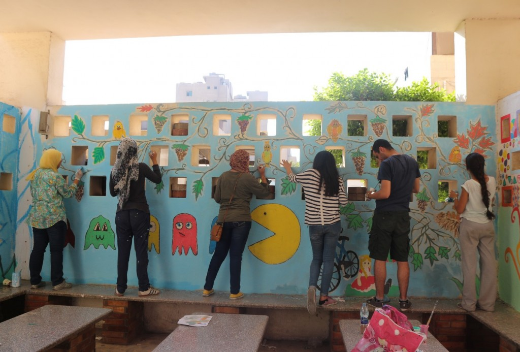 Volunteers add colours and drawings to the walls that the children see during their stay at the hospital (Credit: Leena ElDeeb)