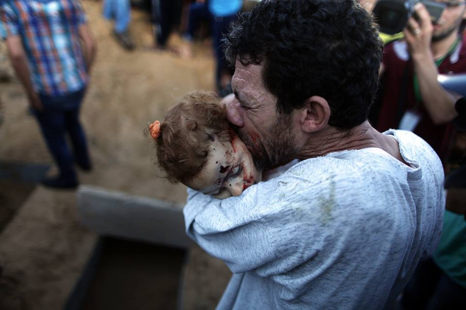 A father says his last good bye to his daughter that was killed in an Israeli air-strike in Gaza.