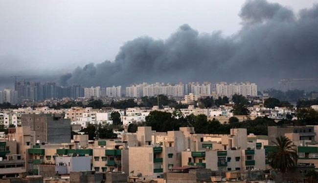 Smoke billows over Tripoli during fighting in July 2014.