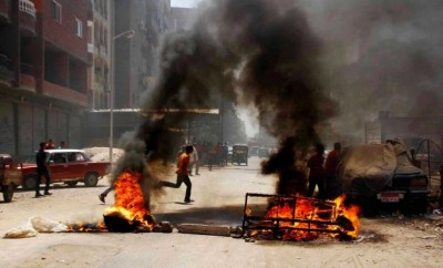 Pro-Morsi demonstrators blocked roads on Thursday, 14 August, by setting fire to waste in Matariya Square, Cairo, Egypt. Photo: AP.