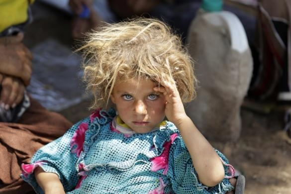 One Yazidi girl among thousands who were able to escape life-threatening conditions on Mount Sinjar to a makeshift refugee camp in Dohuk province in this Reuters image.