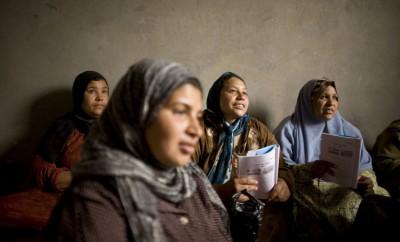 Women attending an illiteracy class. Photo: Laura Boushnak.
