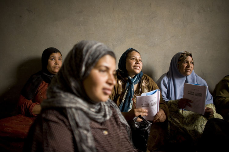 Women attending an illiteracy class. Photo: Laura Boushnak.