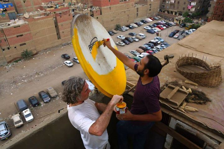 Stoneking starts his project by painting dishes on the art space's roof (Photo by Giacomo Crescenzi)