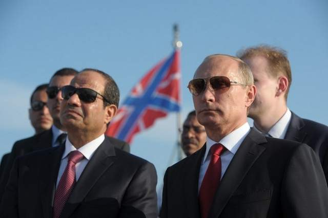 Russian President Vladimir Putin, right, and Egyptian President Abdel Fattah el-Sisi visit the Black Sea Fleet's missile cruiser Moskva on Aug. 12 in the sea port of Sochi. (Alexei Druzhinin / AFP)