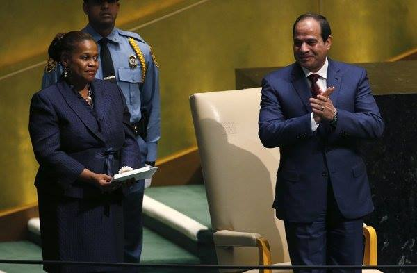 Egypt's President Sisi acknowledges the applause he received upon approaching the podium