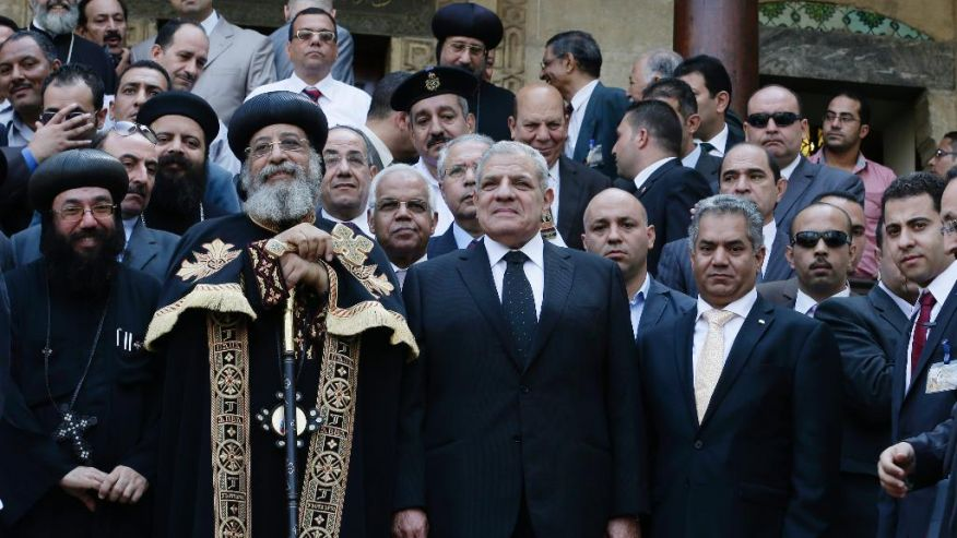 Coptic Pope Tawadros II and Egypt's Prime Minister Mehleb attend the opening ceremony