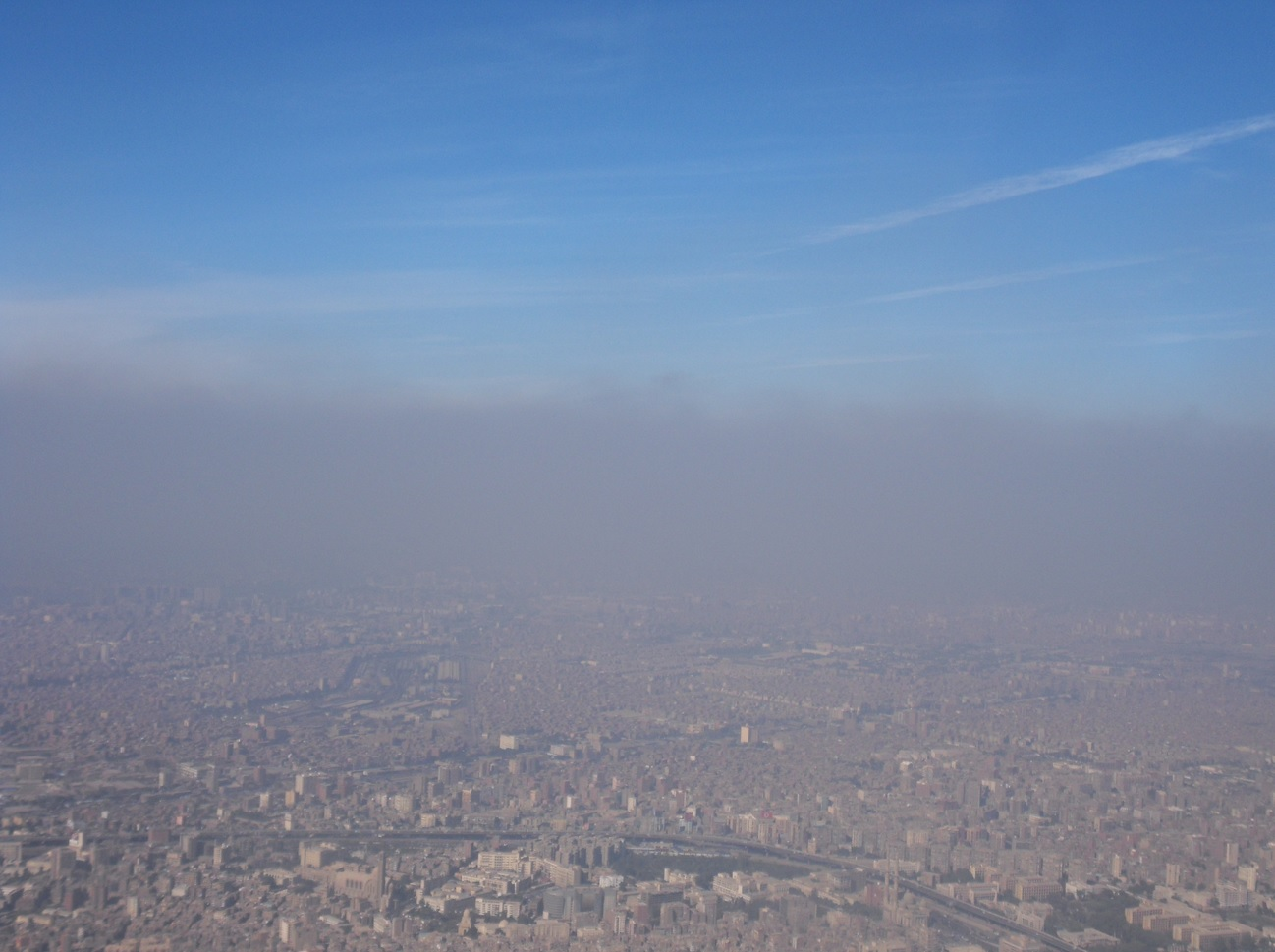 Black cloud as seen from an airplane over Cairo in 2013.