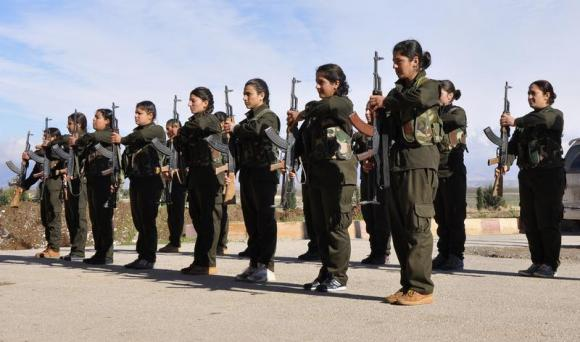 Kurdish female fighters of the Kurdish People's Protection Units (YPJ) hold their weapons at a military training camp in Malikiya, Hassaka province December 9, 2013. Credit: Reuters/Rodi Said