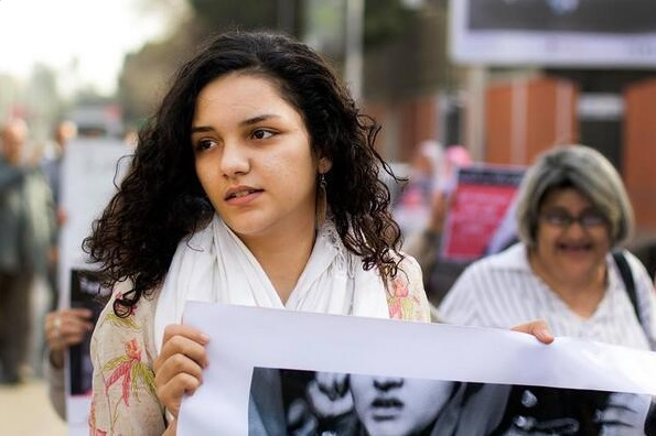 Sanaa Seif, one of 23 sentenced to three years in prison for violating the protest law.