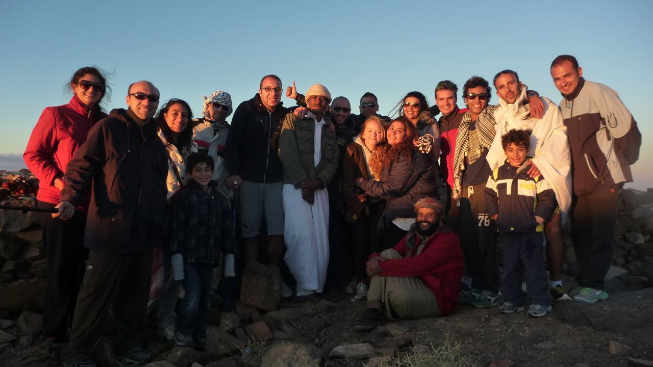 Nasr Mansour, the chief Bedouin guide, surrounded by hikers on Jebel Abbas Basha