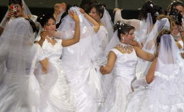 Newly wed brides dance at a mass wedding ceremony in Cairo, Egypt (2010).