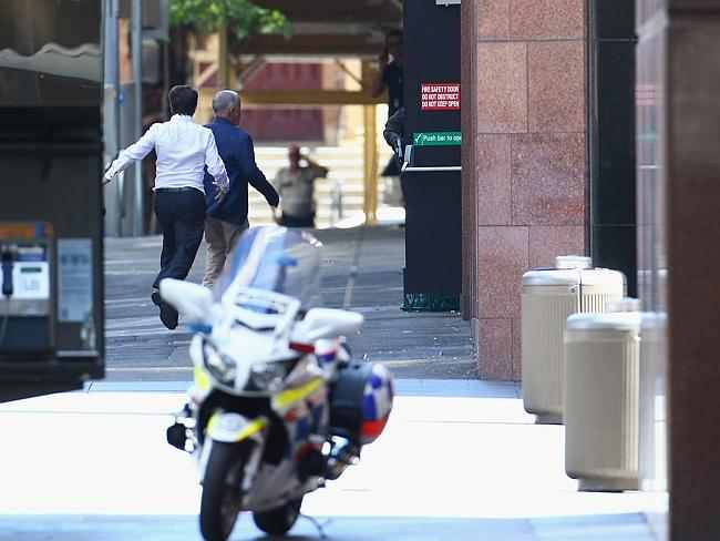 Two hostages flee the Sydney cafe. Credit: Getty Images