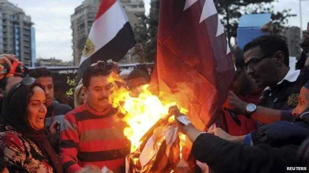 Protesters burn Qatari flag in Cairo earlier this year.