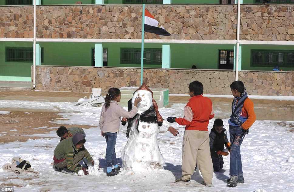 Children in Saint Catherine had the rare opportunity to build a snowman at school in December 2013