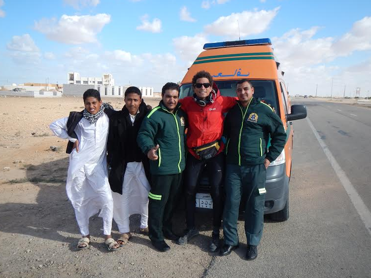 This ambulance car decided to stop when it bumped into my way to Saloum. They knew that I was the guy who is touring around Egypt by bike, and they decided to take a picture with me.