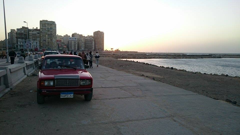 Illegally parked car on the sidewalk along the corniche