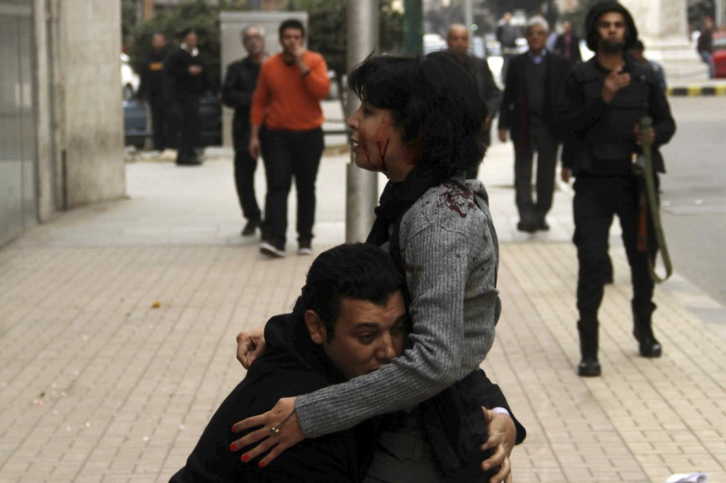 SPAP activist Sabbagh receives help after she was shot during a protest by the party in Cairo