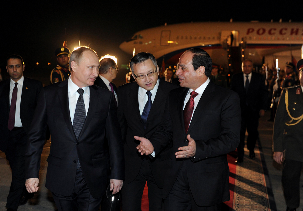 It was all smiles as the Russian President landed in Cairo. REUTERS/Mikhail Klimentyev/RIA Novosti/Kremlin