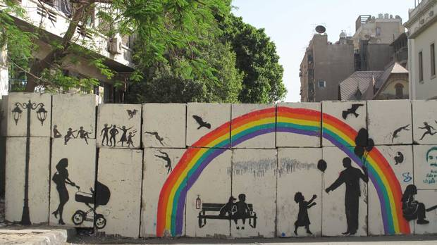 Artwork titled, Tomorrow, painted by El-Zeft on the walls of Mansour street in Cairo, Egypt. The painting shows an image that contrasts with the current reality; the rainbow and playfulness display an idealistic future that contrasts with the massacres that are taking place. (Photo credit: Mia Grondahl)