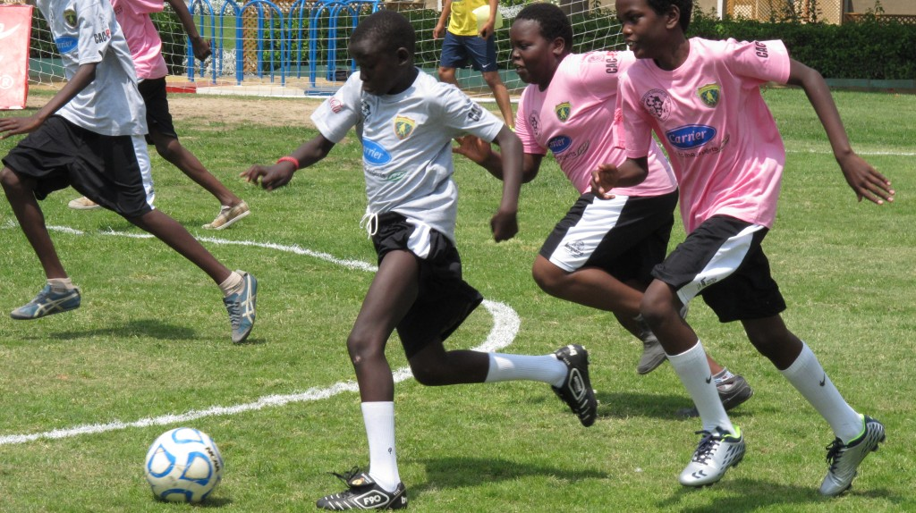 African refugees in a soccer match from last year's EIS event. [Courtesy of EIS]