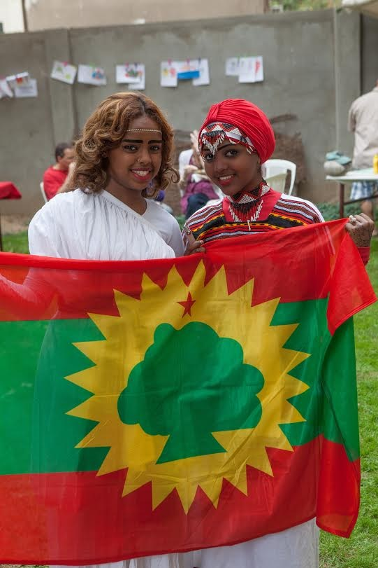 Students of AHLC wearing traditional Eritrean attire, posing with their national flag. As part of the festivities, these girls donned traditional clothing to accompany their dance performances. Fair goers could enjoy traditional Eritrean tsebhi (stew) served with injera (a type of flatbread) along with many other varieties of African cuisine.