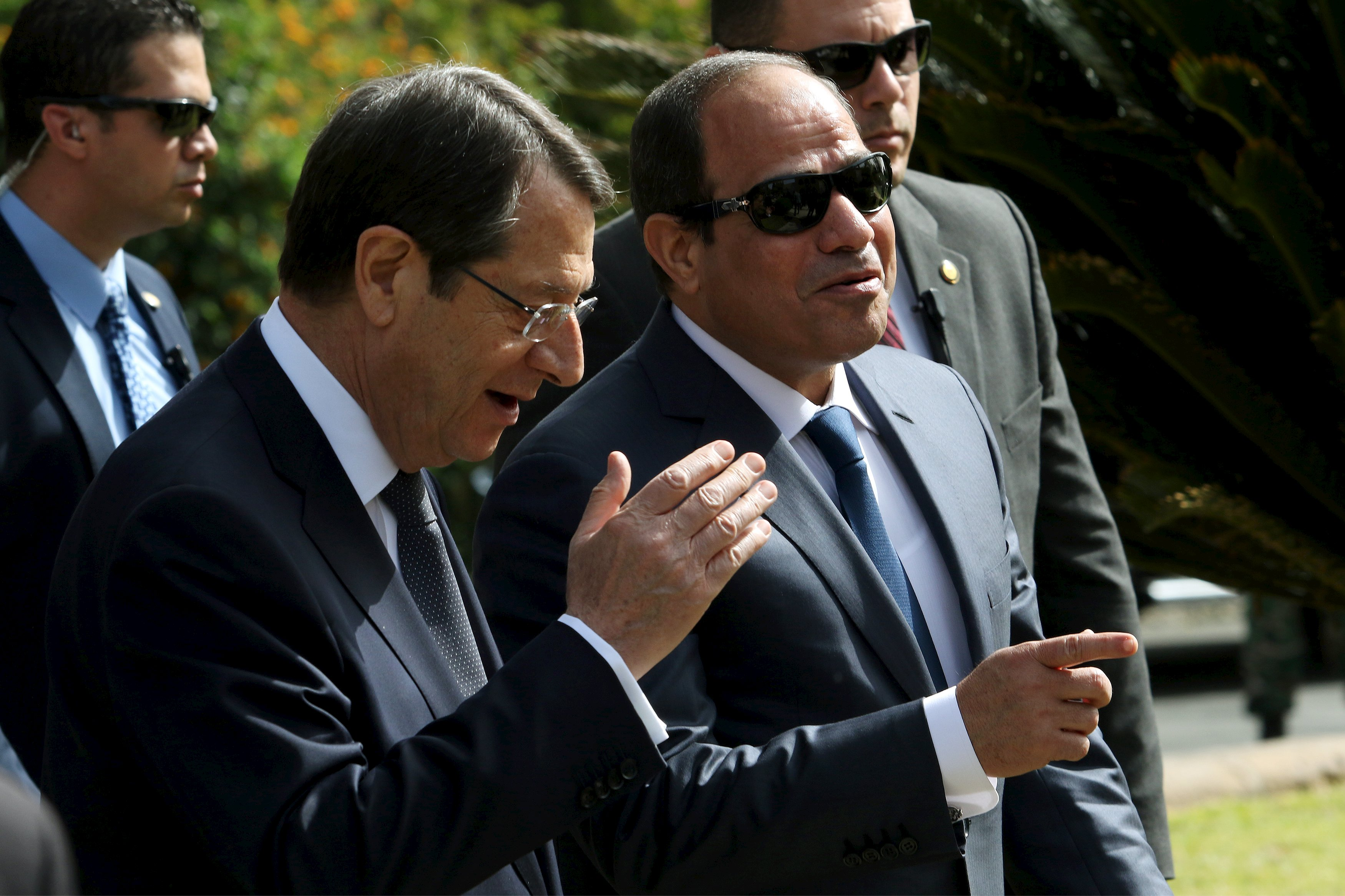 Cypriot President Nicos Anastasiades (L) and Egyptian President Abdel Fattah al-Sisi chat as they enter the Presidential Palace in Nicosia, April 29, 2015. Sisi was in Cyprus to discuss regional cooperation with Anastasiades and Greek Prime Minister Alexis Tsipras.  REUTERS/Yiannis Kourtoglou