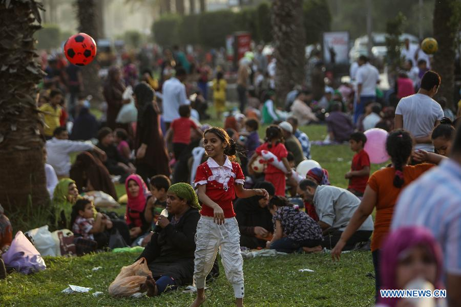 Egyptian families celebrate Sham El-Nessim in 2013 at a park in Cairo. Credit: Amru Salahuddien