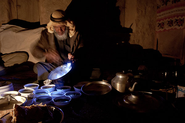 Dr. Ahmad, a renowned veteran of herbology in Sinai, preparing dinner for a number of guests