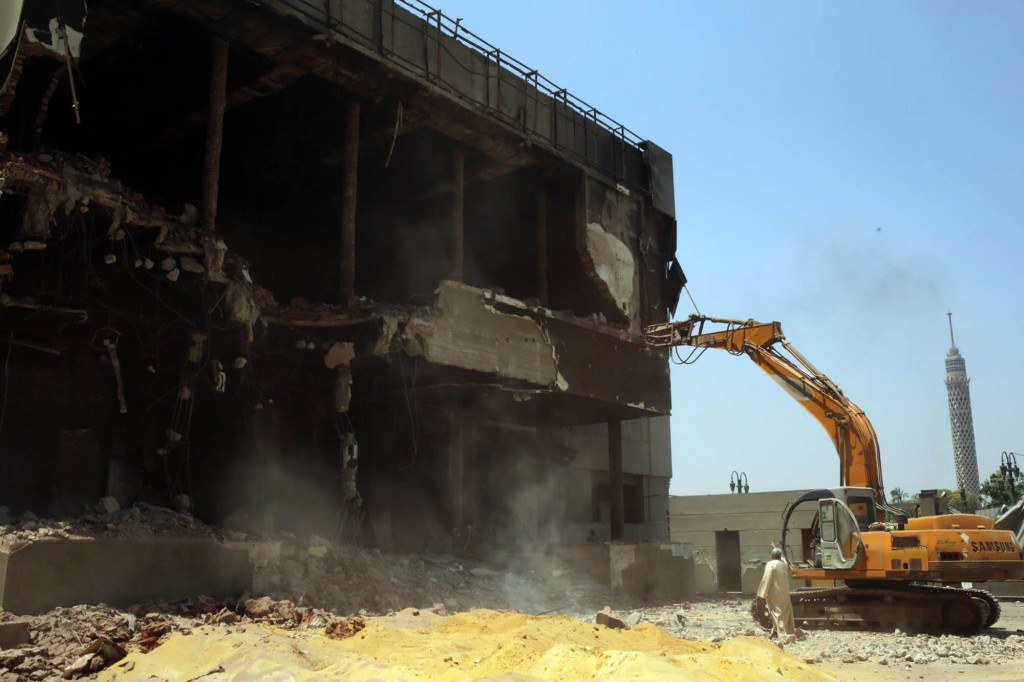 The beginning of the demolition of a building belonging to the now defunct National Democratic Party on Sunday, May 31, 2015. ASWAT MASRIYA/Randa Shaath