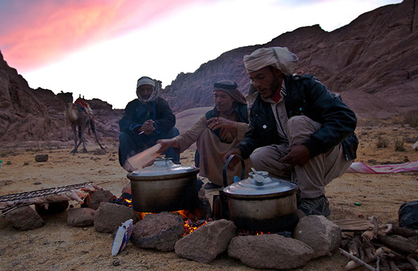 Tribesmen in St. Catherine, Sinai, cooking dinner on the way up to Mount Sinai. Credit: Enas El Masry