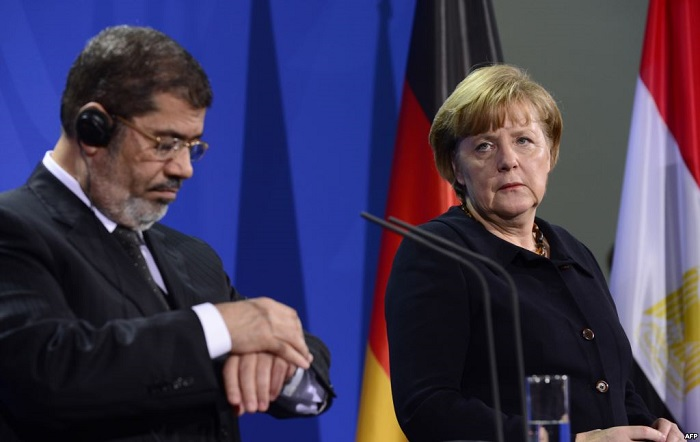 Egypt's deposed President Mohammed Morsi met with Chancellor Merkel during a visit to Berlin in 2013.