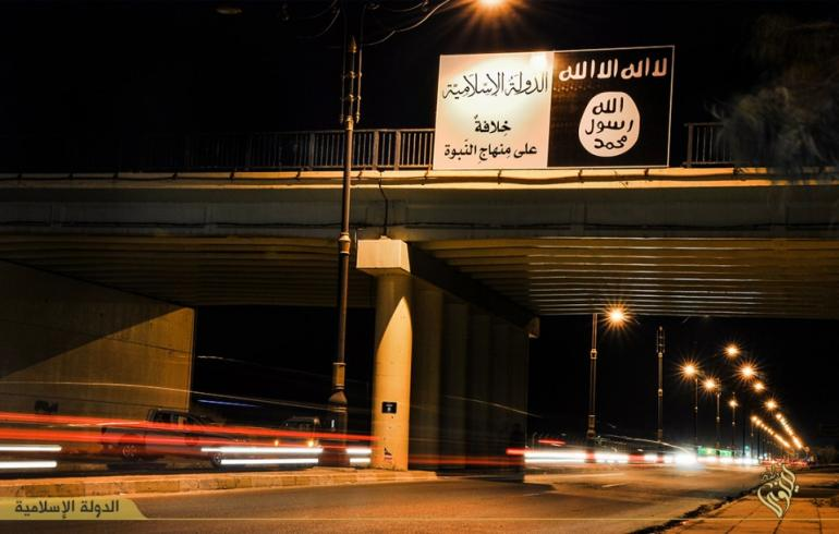 The Islamic State group's flag over a bridge in Mosul