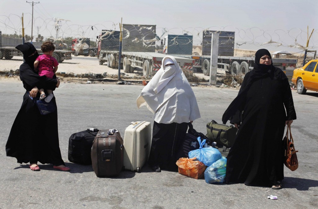 Palestinian passengers wait to leave Rafah crossing between Egypt and southern Gaza Strip after the crossing's closure