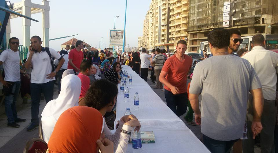 People patiently waiting at the iftar table before sunset. Credit: Nesma Elgohary