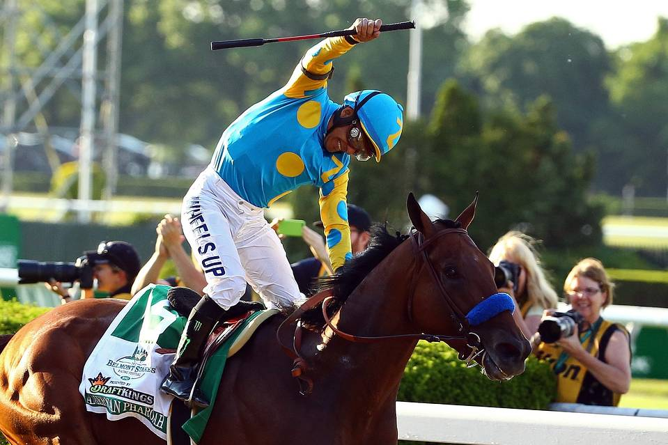 Victor Espinoza celebrates atop American Pharoah #5 (Getty Images)