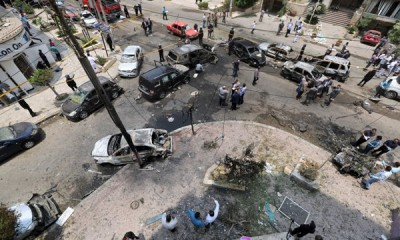 A view shows burnt cars at the site of a car bomb attacked the convoy of Egyptian public prosecutor Hisham Barakat near his house at Heliopolis district in Cairo, June 29, 2015.  REUTERS/Mohamed Abd El Ghany