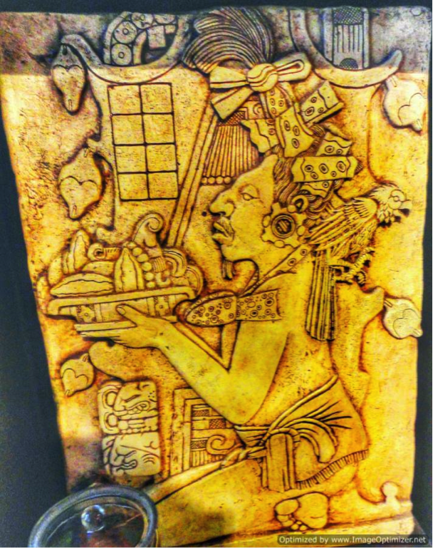 King Montezuma offering cocoa nibbles to Aztec gods