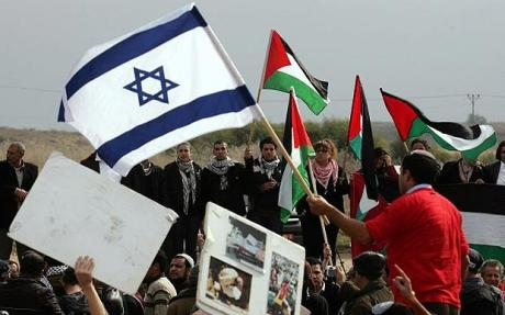 An Israeli activist waves his national flag at Israeli Arab demonstrators waving Palestinian flags. Credit: AFP